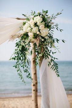 Rustic beach arbor: http://www.stylemepretty.com/2015/11/02/rustic-romantic-michigan-beach-wedding/ | Photography: Katie Kett - http://katiekettphotography.com/