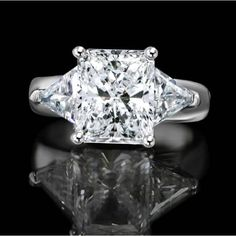 6 CT. Radiant Rectangular Classic wide shank ring w/Zirconite triangular sides(1 CT. TW.) simulated diamond - Diamond Veneer. Set in sterling silver Platinum electroplate.635R72090