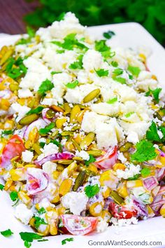 Our Easy Mexican Corn Salad is inspired by the street food south-of-the-border. It's a tangy, sweet and savory side for anything coming off your grill this summer. Mexican Corn Salad, Mexican Food Recipes, Ethnic Recipes, Mexican Dishes, Jewish Recipes, Veggie Side Dishes, Corn Dishes, Corn Salads, Pasta