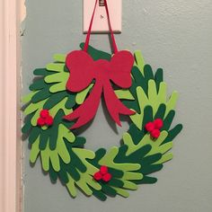 Diy toddler hand holiday wreath made out of foam sheets. Christmas Crafts For Toddlers, Christmas Crafts For Kids To Make, Christmas Paper Crafts, Preschool Christmas, Christmas Activities, Toddler Crafts, Preschool Crafts, Kids Christmas, Christmas Decorations
