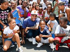 Chris Brown Handing Out Shoes to Needy Kids[PHOTOS]