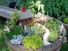 How To Make A Fairy Garden Container How To Create A Fairy Garden In A Container Flea Market Gardening Mini Fairy Garden, Gnome Garden, Garden Planters, Fairy Gardening, Garden Whimsy, Garden Junk, Garden Cottage, Garden Sheds, Glass Garden