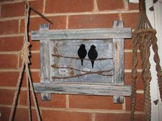 Tin Lovebirds on barbed wire in wooden frame