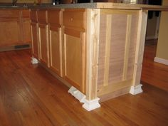 Kitchen Island Makeover Ideas beef up a kitchen island with board/batten, 2x4 corners, and