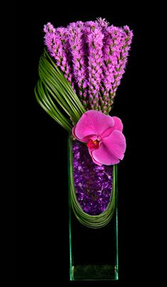 Striking purple floral design of liatris, orchids and grass.