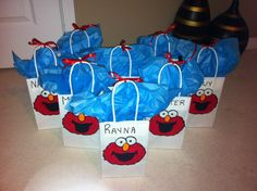 Goodie bags with Elmo painted on them.