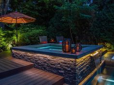 Mood lighting, a private setting and a stylish design from Platinum Poolcare make this plunge pool the ideal choice for a midnight dip. The stamped concrete deck with composite wood decking provides the handsome framing for a pool that features interlocking natural stone veneer, stamped concrete coping and a stainless steel scupper.