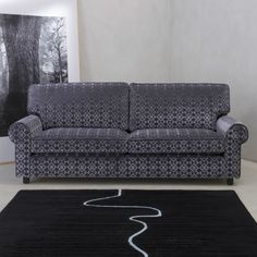 Sofa in Mithra 10275, a geometric velvet.