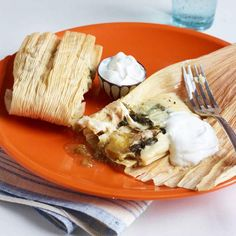 Cheesy Chicken Tamales are a versatile dish. Make them with chopped broccoli and cheddar for a #meatlessmonday meal! | http://www.rachaelraymag.com/recipe/cheesy-chicken-tamales/