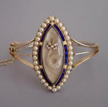 """Gold mourning bracelet with seed pearls and blue enamel, English, c. 1893. Engraving on the back: """"John Burdon, b. Octr 14th 1811, d. Novr 12th 1893"""". Rev. John Burdon was a son of Rowland Burdon and lived at Castle Eden Dene in northern England."""