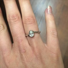 We love this #amazing 0.7ct #pearcut #diamond is delicately set in a #platinum rub over, #bespoke made by our Selini #designer Robin Girling!  #beautiful #engagementring #instawed #luxury #style #selinijewellery #design #diamondring #love #engaged