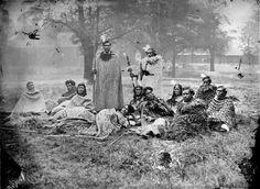 Maori group who visited England with William Jenkins in 1863-1864. From left to right: Takerei Ngawaka, Hirini Pakia (Hariata Te Iringa), Horomona Te Atua & Hapimana Ngapiko (both standing), Hare Pomare (reclining), Hariata Pomare, Kamariera Te Hautakiri Wharepapa, Huria Ngahuia, Kihirini Te Tuahu, Reihana Te Taukawau & Paratene Te Manu.