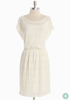 """This romantic cream dress is crafted in an impossibly soft sheer lace with the perfect touch of sheen, a hint of stretch, and an elasticized waist for a flattering and defined fit. Partially lined. Removable slip. Pair with a cardigan and mary janes for timelessly classic style.95% Nylon, 5% Spandex, Made in USA, 38.5"""" length fro..."""