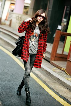 A edgy and casual look that is perfectly tied together with the red plaid overshirt.
