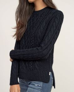 Womens Cable Knit Pullover | The cozy essential that you'll wear season after season. Iconic soft cable knit detailed with a hi-lo hem and ribbed trim, finished with a logo patch at left hem, Easy Fit | http://Abercrombie.com