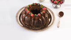 This gorgeous chocolate caramel holiday cake will satisfy your sweet tooth with a dark chocolate ganache and a garnish of frosted berries Lindt Chocolate, Chocolate Bundt Cake, Chocolate Truffles, Melting Chocolate, Chocolat Lindt, Caramel, Holiday Cakes, Vegetarian Chocolate, Sweet Tooth
