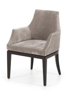 The Taylor dining chair. This contemporary dining chair is a perfect addition to both residential and commercial settings. This sophisticated chair features show-wood finish plinth and legs and its curved shape with padded back and arms exude comfort and style.