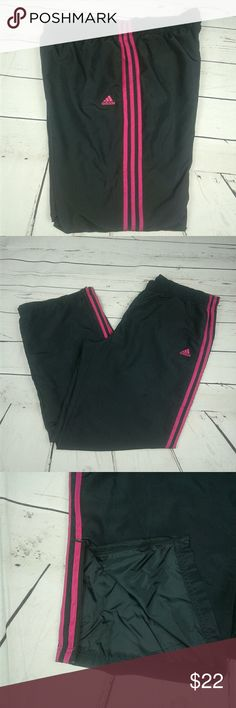 Adidas windbreaker track pants Dark gray track pants with pink stripes and logo. 2 pocket, zippers at bottom. Drawstring waist. 4th pic shows peak at inside that is mesh. These are the swishy material. Last pic shows very small place of pilling. So small could barely get it in close up. 100% polyester.  Laying flat elastic waist is 17.5 inches. Inseam is 31 inches. adidas Pants Track Pants & Joggers