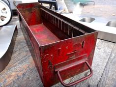 LOVE this red vintage industrial cubby.