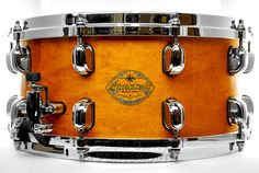 Tama Starclassic Maple Snare Drum 14x6.5 Honey Gold - Made in Japan!  This drum is a 14x6.5 reinforced maple shell in classic Honey Gold with a stunning gloss finish!   We hope you're excited about these drums as much as we are. We here at DCP are constantly striving to offer products that you won't see anywhere else, and I feel these drums are a great example.   Purchase Here: http://www.drumcenternh.com/drums/snare-drums/tama-starclassic-maple-made-in-japan-snare-drum-14x6-5.html