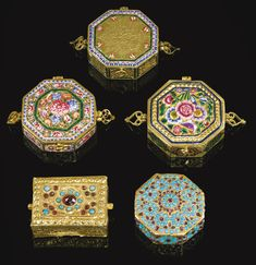 A GROUP OF FIVE QAJAR GOLD, ENAMELLED AND JEWELLED MINIATURE QUR'AN CASES, PERSIA, 19TH/20TH CENTURY comprising four octagonal boxes and one rectangular, three with polychrome enamel floral decoration with palmette shaped handles, two of which feature a motif of the personification of the sun to underside and two with calligraphic cartouches, the other two set with turquoise and garnets with repoussé designs