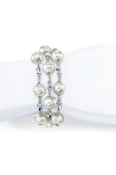"""Sterling Silver 9mm White Freshwater Pearl & Crystal Triple Row Bracelet    - Sterling silver white freshwater pearl and faceted crystal link triple row bracelet   - Affixed with a sterling silver lobster clasp  - Standard 7.5"""" length (can be adjusted with lobster clasp)  - Approx. 9mm pearls  - Accompanied by a certificate of authenticity  - made in the USA  - $79.00 at hautelook"""