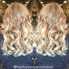 Golden blonde base color with bright blonde baby lights and balayage