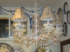 teacup chandelier--just bought a light fixture at Goodwill to do this!