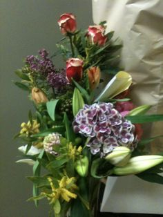 Mimosa, hydrangea, tulips, roses, brunia, unopened casa Blanca lilies, a sprig of lilac An educated bunch.