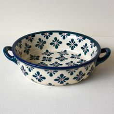 Polish Pottery Haven't seen this dish with handles before.