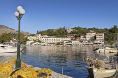 Melina Bay Hotel Kassiopi & Kelia Boutique Hotel. A lovely hotel at the heart of Kassiopi's harbour, Melina Bay makes a stylishly modern statement, against a backdrop of the medieval castle. An excellent choice for couples, it is family friendly too.