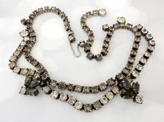 Smokey Kramer rhinestone necklace recalls the sultry elegance of the 1950s.  Vintage rhinestone jewelry the ultimate in recycled beauty.