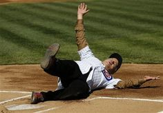 Actor Bill Murray slides into home after rounding the bases before throwing out a ceremonial first pitch before a opening day baseball game between the Chicago Cubs and the Washington Nationals Thursday, April 5, 2012, in Chicago. The Nationals won 2-1.