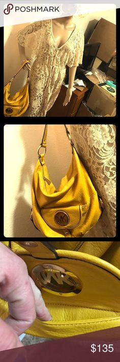 Women's yellow leather M k hobo bag Gold hardware This bag is very pretty the color is what I'm referring to. It is a great summertime color. It's fairly large with lots of room. It has a zipper pocket inside on one side and then on each side there are two little compartments for credit cards, Waller's licenses money etc. phone lipstick. It is in very good condition. It has one or two small pink ink stains inside the bag. I have not tried to get them out. It has a gold hardware. It has an…