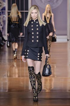 A military jacket and matching skirt with knee high boots