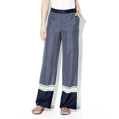 BORDERED TILE PRINT PANT    A resort ready print that will whisk you away to paradise, meet the Wide Leg Tile Print Pant from Vince Camuto. We constructed this flowing pant from our lavish tile print. The thick bands of navy detailing add detail, define the waistline, and accentuate a pretty pair of sandals.