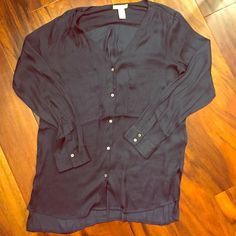 H&M long sleeve shirt Never worn, Button up long sleeve blouse .100% polyester.dark navy color with tiny diamond shapes. H&M Tops Button Down Shirts