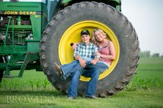 Engagement photo shoot on a farm. Awesome idea to sit in a tractor tire!