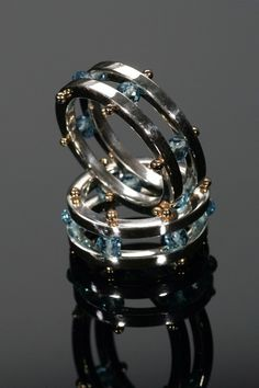 Captive Gem Nautical Rings by Anthony Angel Fine Jewelry (http://anthonyangel.com). Hand fabricated using Sterling Silver, 18k Yellow Gold and Swiss Blue Topaz.