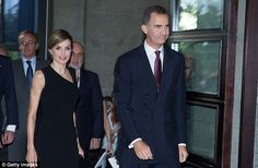 The royals smile at fans as they catch the premiere of Roberto Devereux at Madrid's Teatro...