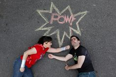 A clever engagement shot idea for the comic book lovers! | Karen Ard Photography