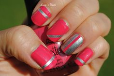 Pink and silver with stripes (created by using tape) nail art design