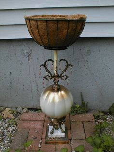 plant stand using an old lamp, with a hanging basket (sans chain) attached to the top.