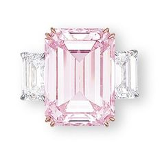 THE PERFECT PINK A SUPERB COLOURED DIAMOND AND DIAMOND RING Set with a rectangular-shaped fancy intense pink diamond weighing 14.23 carats, flanked on either side by a rectangular-shaped diamond weighing 1.73 and 1.67 carats, mounted in 18k rose and white gold.
