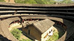 Looking like a Roman coliseum crossed with a doughnut, China's tulou buildings are some of the most stunning -- and threatened -- structures in the country.