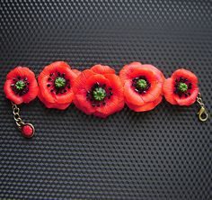 Poppy bracelet, a statement piece. I'm going to figure out how to make this... somehow.