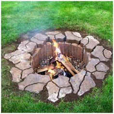 Dig a large circular hole, 2-3ft deep.   Line bottom with landscaping rock, make sure to cover the bottom in a consistent layer. Line sides with red FIRE BRICK (not regular brick--thanks to William for the edited info).  Line the top with landscaping brick, in a design of your liking.