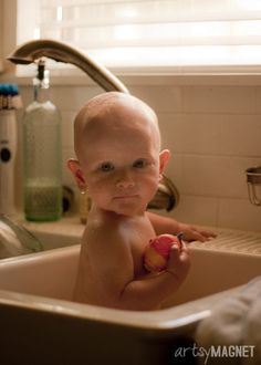"""Baby bathing in the kitchen sink.  """"Nuff said."""