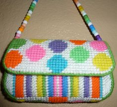 I love the colors and pattern on this... The strap is really cute too!