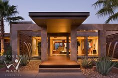 luxury architectural images by roger wade, front entry of contemporary home with water fountains at twilight, private residence, palm desert, california, by studio waterman